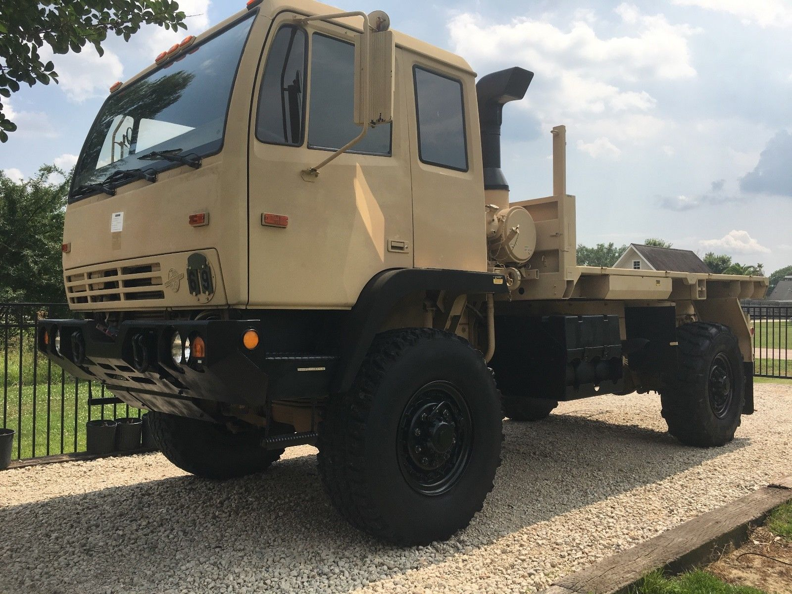 clean 1998 Stewart & Stevenson LMTV M1078 4X4 Military Flatbed Truck for sale