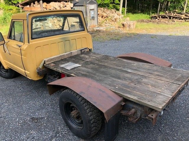 solid 1980 AMC Jeep flat bed pickup military